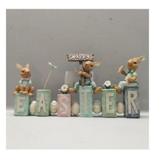Easter Bunnies Sitting On Fence